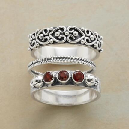 Your three-piece silver sonnet ring set will be poetry to the eyes.