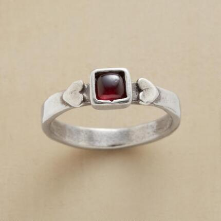 Sweetly simple, you'll adore this red garnet & silver hearts embrace ring.