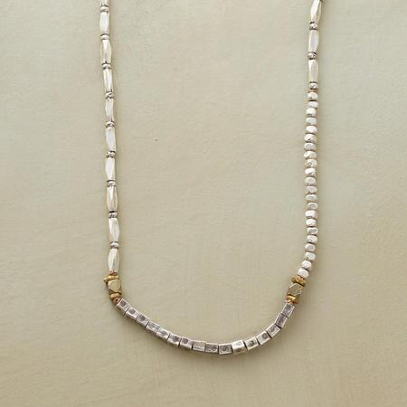 This brass and sterling beaded necklace adds a dash of understated style to any look.