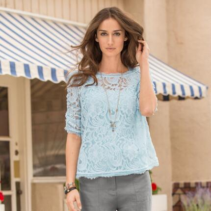 Elegantly versatile, this lace blouse looks just as lovely with casual jeans as with a crisp skirt.