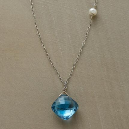 A blue topaz and pearl necklace that offers a touch of minimalist glamour.