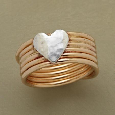 Full with sweet promise, this cross my heart coil ring is an utterly lovely piece.