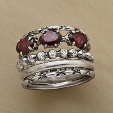 The mixed elements of this red garnets band ring lend an air of glamour and mystery to the piece.