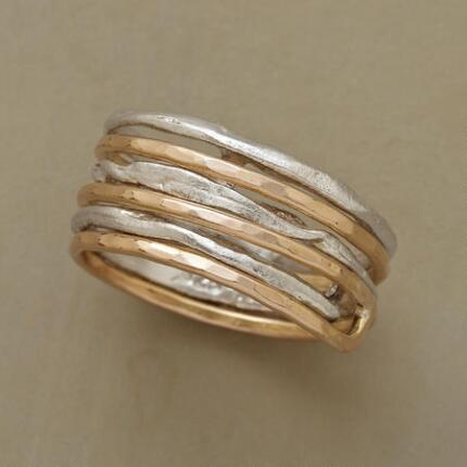 This spiral ring's bright charm will have you wound around its finger.