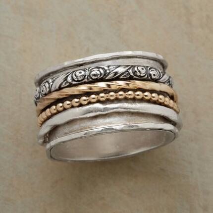 The subtle grace of this anthology band ring will complement any ensemble.