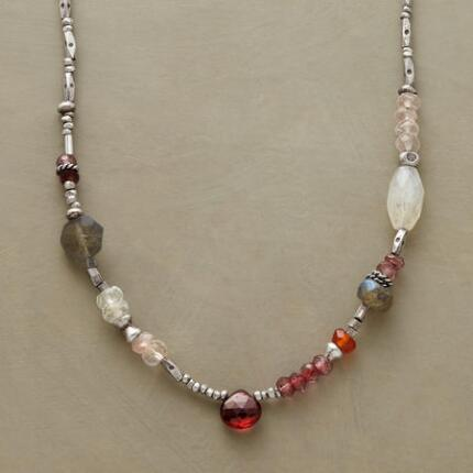 In a refreshing mix of materials, this garnet teardrop and gemstone necklace is a breath of fresh style.