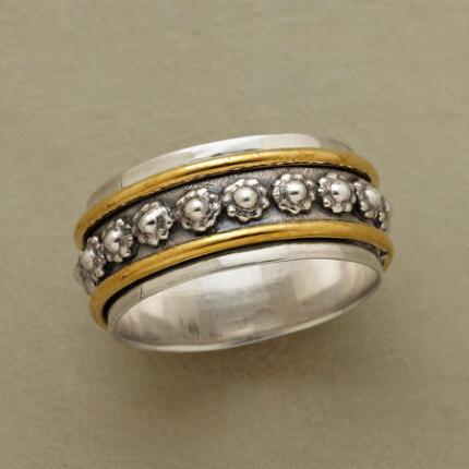 Romance springs alive between lines of brass in this beaded flower ring.