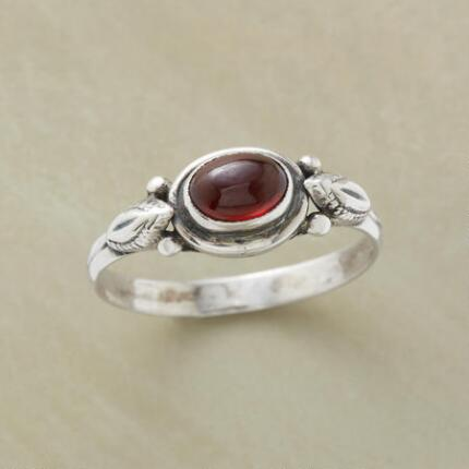 This garnet cabochon ring's handcrafted charm and warmth will attract attention.