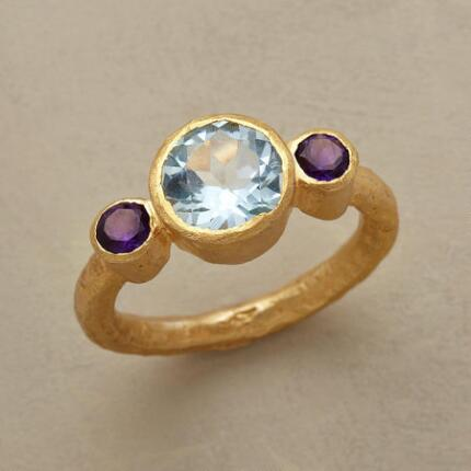 A brilliant artisan gemstone Isis ring with an aura of timeless romance.