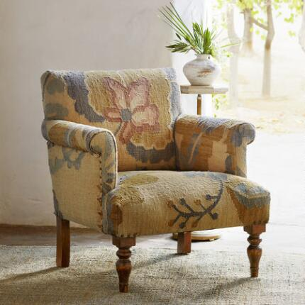 This unique floral roll arm chair will bring a hushed beauty to any space.