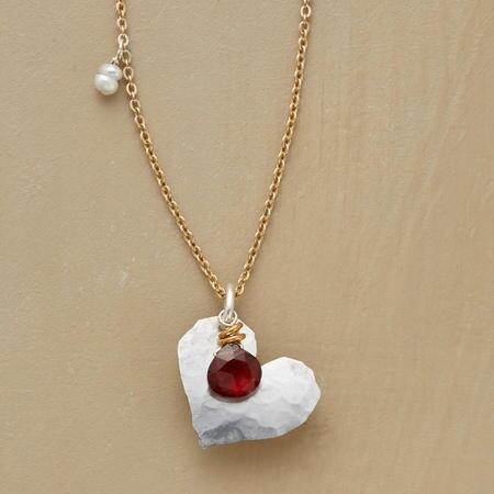 A heart and garnet pendant necklace that you will simply fall in love with.