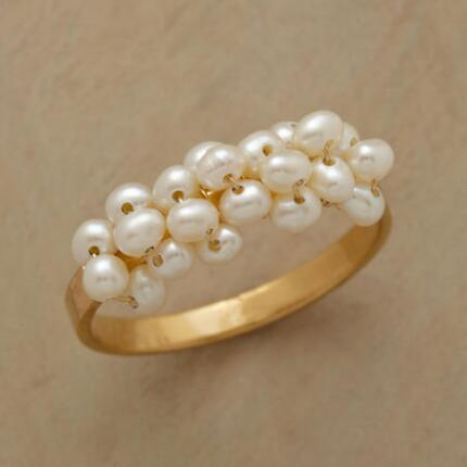 The effervescent charm of this tiny bubbles pearl ring will brighten any day.