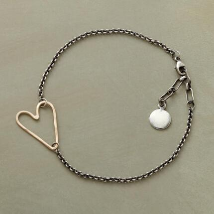 A gold heart link bracelet with a stunning design that makes it one of a kind.