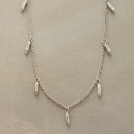 With its classic design, this sterling silver beaded choker necklace adds effortless style to any outfit.