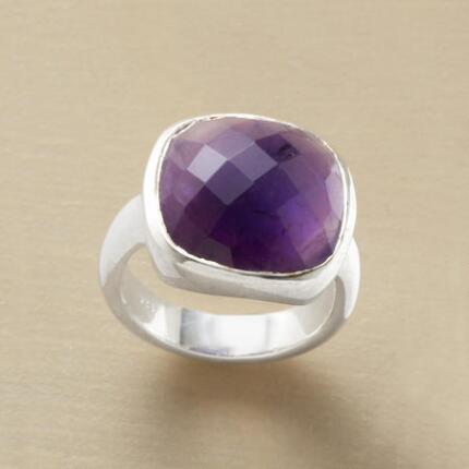 This cushion-cut amethyst & silver ring has a color so rich as to be called regal.