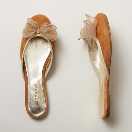 These suede slide flat shoes will enhance any look with a touch of romance.