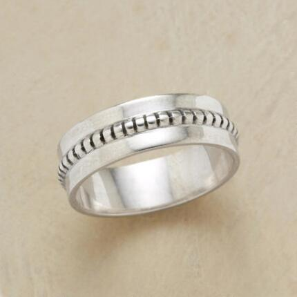 This ridged equator ring adds variety to a classic design with its raised details.