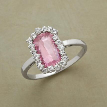 A pink topaz & white sapphire ring that dazzles with its elegance.