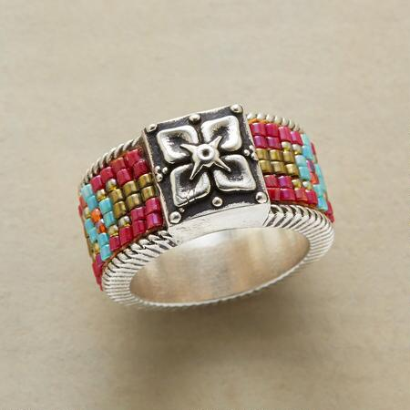 Lovely and lively at the same time, this handmade silver flower motif ring will make your look blossom.