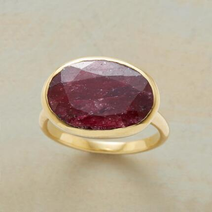 You'll make a majestic impression with this 14kt gold red corundum ring.