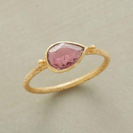 A pretty handmade pink tourmaline ring that charms with its delicate simplicity.