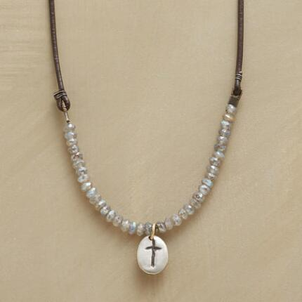 A Rebecca Lankford cross necklace that enhances its central symbol with a host of gemstones.