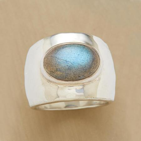 Make a uniquely elegant statement with this hand-hammered silver band ring.