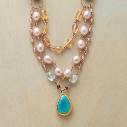 This lovely Jes MaHarry turquoise teardrop necklace is unlike any other.