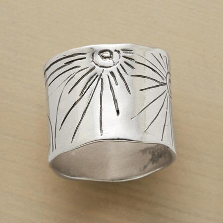 The simple embellishments of this handmade silver band ring set it apart.