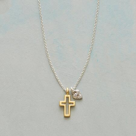 The cutout design of the central symbol in this cross and heart necklace sets it apart.