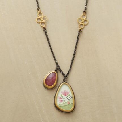 This pink sapphire and painted magnolia necklace is a timeless piece of artwork for the wearing.