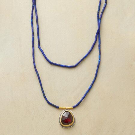 This gorgeous lapis beaded garnet necklace stuns with its sumptuous hues.