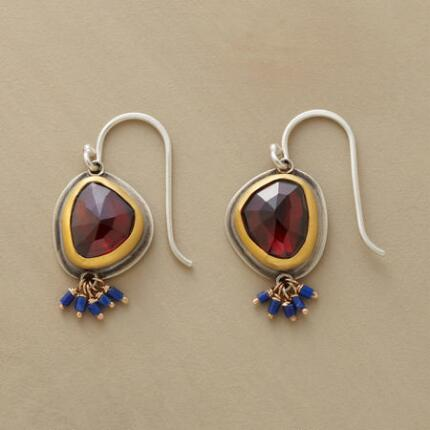 A pair of Ananda Khalsa garnet and lapis earrings that stuns with its sumptuous hues.