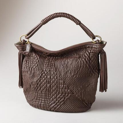 The subtly elaborate design of this quilted lamb leather bag makes it a versatile stunner.