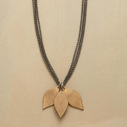 This three-leaf bronze necklace allows its pendants to flutter as though caught by a breeze on the branch.