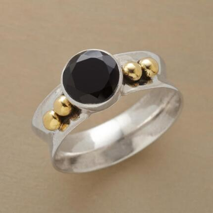 Featuring a dark stone set in a bright band, this midnight sun ring is a stunning study in contrast.