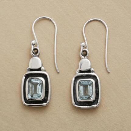 These exclusive silver and topaz earrings exude an air of cool refinement.