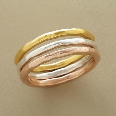 Gleaming its way across the metallic spectrum, this lovely tricolor ring set makes a glowing impression.