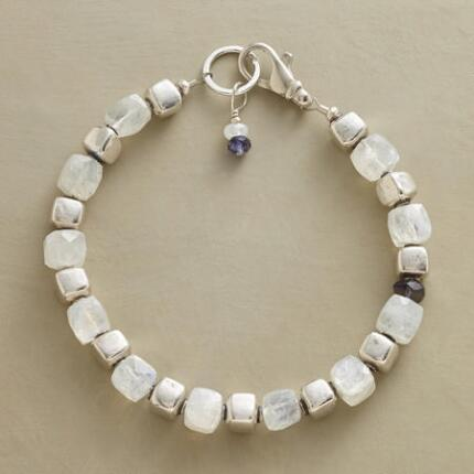 Beautifully blocky, this sterling silver and moonstone bracelet seems to shine with inner light.