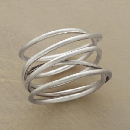 This handcrafted twists & turns coil ring will wear well, whatever curves life throws your way.