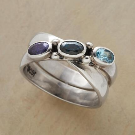 This handcrafted true blues crossover ring lends a subtle sense of variety to any ensemble.