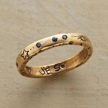 Dark details counterpose the glowing gold band of this blue sapphires heaven ring.