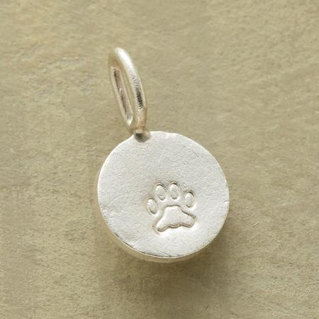 This dog pawprint charm commemorates the love of your canine companion.