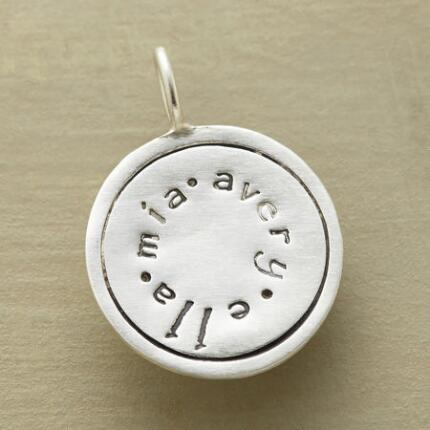 This personalized sterling circle charm makes a lovely personal keepsake or gift.
