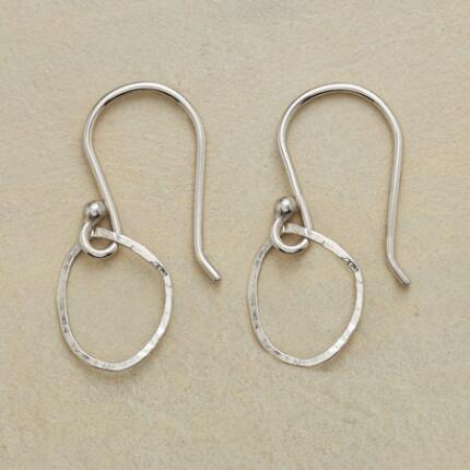 Each pair of these unique handmade white gold hoop earrings is truly one of a kind.