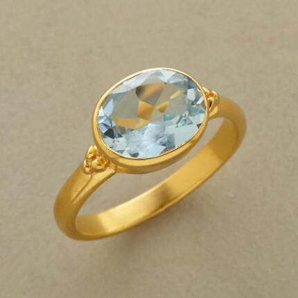 Send a beautifully mixed message with this cool blue topaz ring's stunning contrasts.