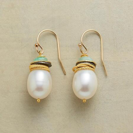 A pair of pearl and emerald earrings that stir admiration with their elegant hues and delicate embellishments.