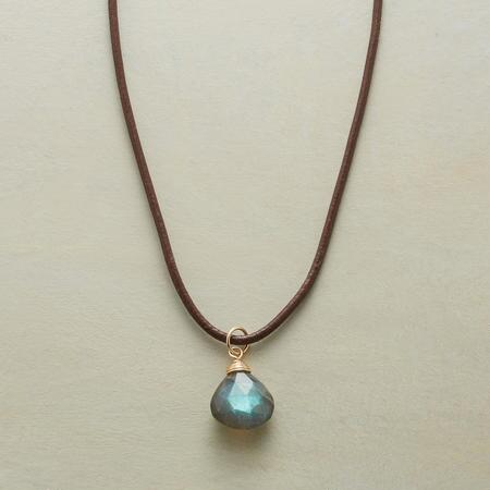A labradorite pendant necklace with a simple design that highlights its bewitching stone's tones.