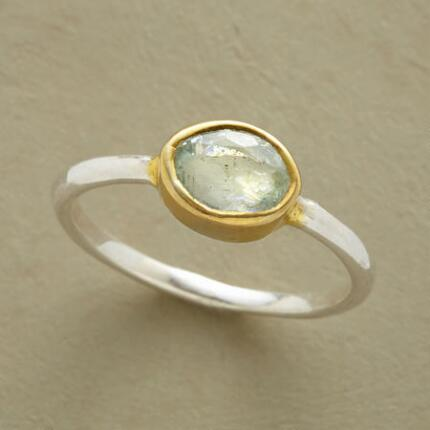 Simple and elegant, this aquamarine halo ring could be worn anytime and anywhere.