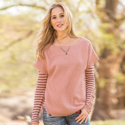 This soft, light cashmere tunic sweater is one you'll love to layer.